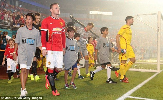 Wayne Rooney and Steven Gerrard lead the teams out at the Sun Life Stadium in Miami Gardens