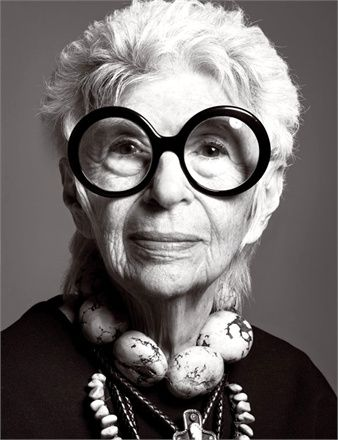 Iris Apfel (1921) is an American businesswoman, interior designer, and fashion icon. Apfel worked for Women's Wear Daily and for interior designer Elinor Johnson. She also was an assistant to illustrator Robert Goodman. Apfel took part in several design restoration projects, including work at the White House: from Truman to Clinton. At age 90 Apfel was a visiting professor at University of Texas at Austin. In 2013, she was listed as one of the fifty best-dressed over 50s by The Guardian.
