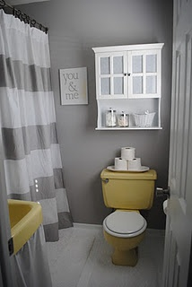 about seventy bucks & lots of ideas to update an ugly bathroom to this. grey & yellow are nice together!