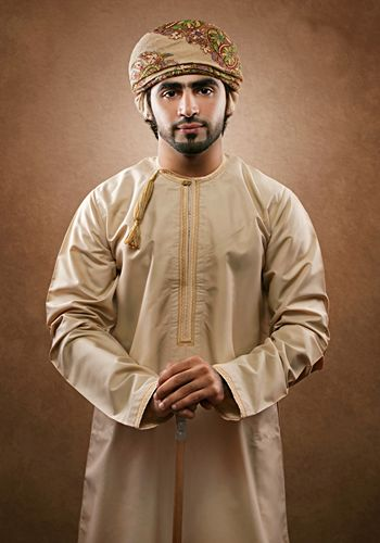 The National Dress For Omani Men Is A Simple Ankle Length
