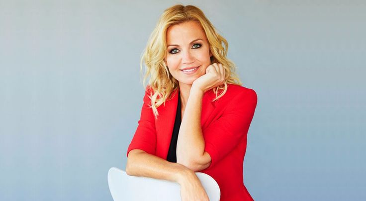 ESPN host and reporter Michelle Beadle in red dress