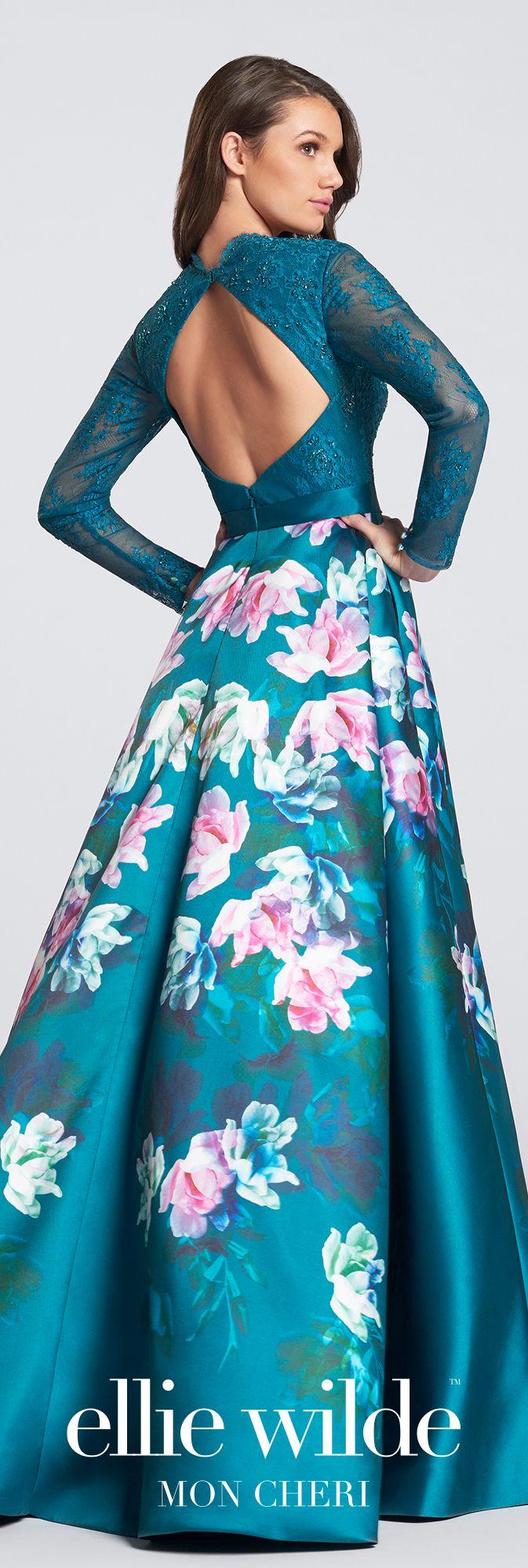 Long sleeve lace bodice floral print prom dress. A-line gown, plunging V-neckline, large keyhole back, Mikado overskirt with side slit, short underskirt.