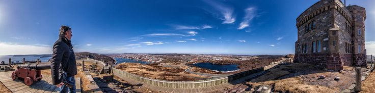 A self portrait of the photographer at Cabot Tower, Signal Hill in St John' Newfoundland Canada. In the photo you can see the city of St John's, Cabot Tower and Cape Spear, the most easterly point in Canada.