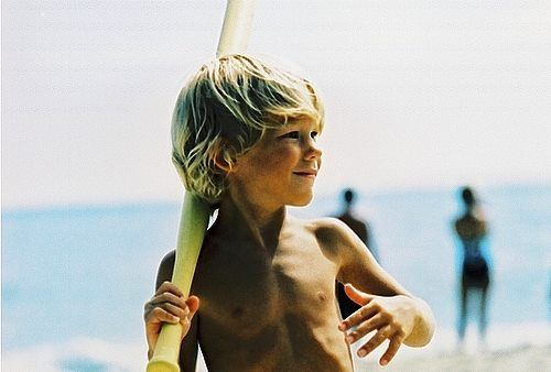 this will be my little blonde boy playing baseball on the beach