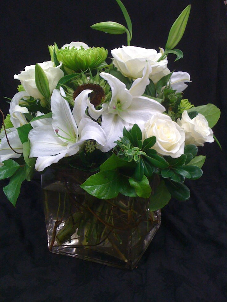 Flower Arrangement White And Green Oriental Casablanca Lilies Naked Sunflowers Green Spider Mums White Roses Greenery Giant Glass Cube
