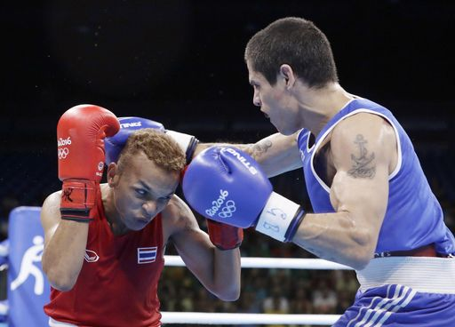Ruenroeng's fight from prison to Olympics and back again  -  August 7, 2016  -      Argentina's Perrin Ignacio, left, fights Thailand's Amnat Ruenroeng during a men's lightweight 60-kg preliminary boxing match at the 2016 Summer Olympics in Rio de Janeiro, Brazil, Sunday, Aug. 7, 2016. (AP Photo/Frank Franklin II)