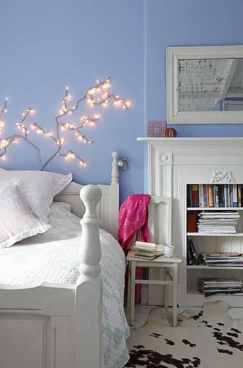 Love the trees above the bed and the bookshelves in the fireplace.  The periwinkle wall is also gorgeous!