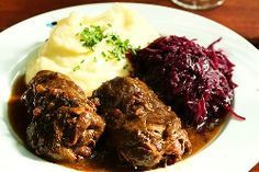 Rouladen (2): Rouladen (or Rinderroulade) is a German meat roulade usually consisting of bacon, onions, mustard and pickles wrapped in thinly sliced beef which is then cooked. In some countries the roulade is also known as Beef Olive.