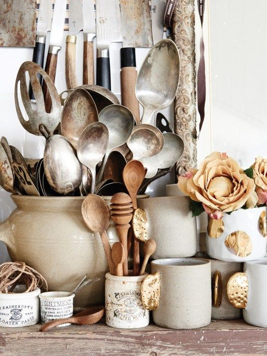 Take a look around the kitchen of Kara Rosenlund's home in Australia! This cottage is a rustic, modest 3 bedroom but nothing short of amazing. It is the perfect example that neutral doesn't have to mean dull and boring. The colour palette is simple , white, wood, warm shades of caramel. Her home is full of vintage pieces brought back from her travels. Just look at that range of kitchenalia for a start!