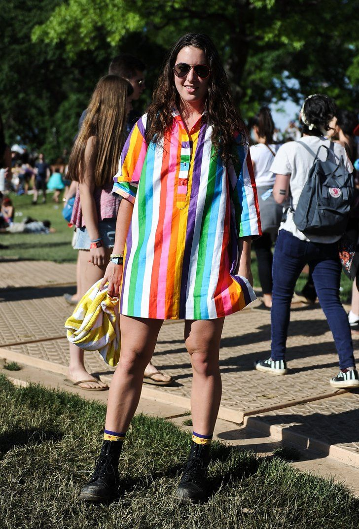 Pin for Later: Casual-Cool Street Style Inspiration From Governors Ball  A vibrant vintage rainbow-striped top got a festival refresh with comfortable boots and aviators.