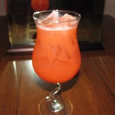 Pierced Fuzzy Navel: 1 oz peach schnapps - 1 oz vodka - 3 ozs orange juice - 1 dash grenadine (optional) - 1 cube ice. Pour the peach schnapps, vodka, orange juice into a shaker with ice. Shake, then strain into a glass. Top with a splash of grenadine if you like.