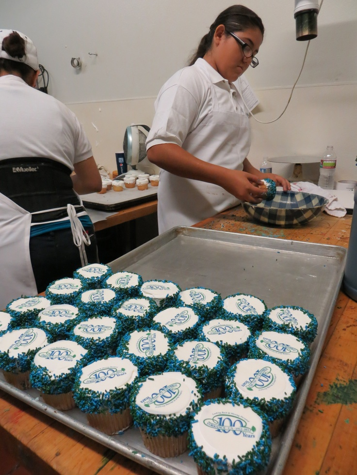 For Torrance's Centennial Celebration, we made festive cupcakes and gave them out for free! Here they are being sprinkled now :)