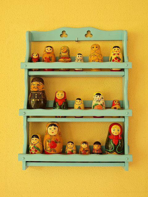Display a matryoshka doll collection on a spice rack