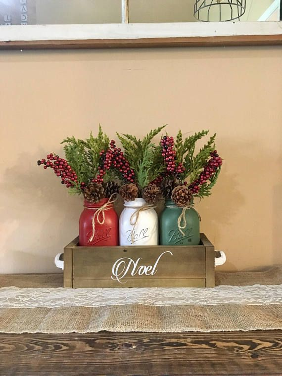 This is a perfect way to ring in the holiday season with this rustic Christmas centerpiece. Dimensions: 12.75x5.5 Quart sized jars Package includes: (1) planter box (dark walnut) with hand painted stencil (3) christmas chalk painted mason jars (3) flowers I can make any size youd like and if these christmas colors dont fit with your decor, tell me, i love doing custom orders