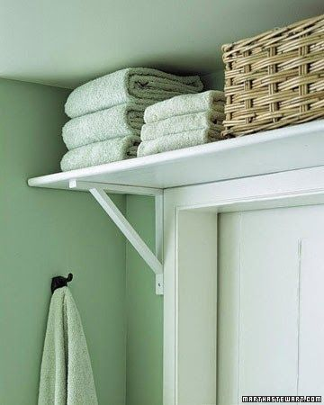 I like the idea of shelves above doorways.