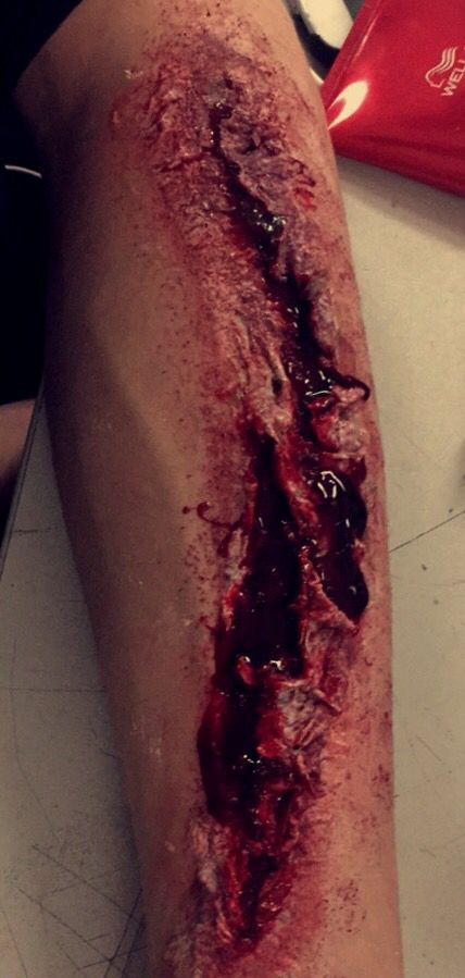 A slash made with liquid latex, tissue, fake blood and body paint. #cut #wound…