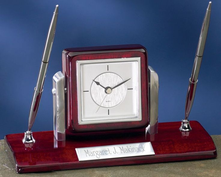 "Our Desk Clock Pen Set features a square swivel clock, two silver pens, and an engraving plate. Item 2220C measures 8 5/8"" x 3 3/8"" x 4 1/2"" in size."
