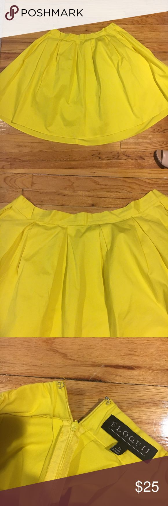 Eloquii Yellow Pleated Midi Skirt Lightly used Eloquii Pleated Skirt. Lemon Yellow color. Size 24. Hidden elastic waist band. Full skirt in cotton twill and is great for layering. Invisible zipper. Box pleats. Does have two small green lines, which are not noticeable from a far. Thread coming off of hook and eye closure. Great for layering with casual pieces and dressing up for night time! Eloquii Skirts Midi