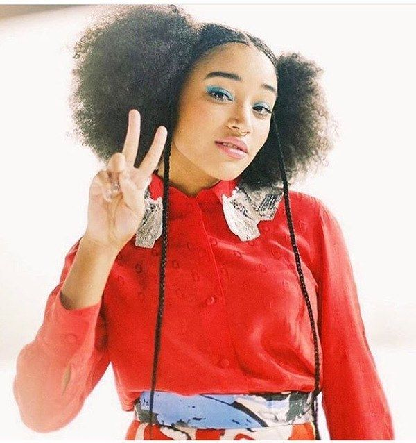 "Amandla Stenberg is taking face-framing hair to the next level, and we are here for it. To get the look, Lacy parted Amandla's hair down the middle and applied Carol's Daughter Monoi Conditioning Mousse before blow drying. ""This keeps the parted section flat and in place,"" she explains. From there, she sectioned skinny, vertical parts on either side of the hairline to create cornrow braids. ""I added Beauty Works hair extensions to extend the braided section for more of a dramatic look,"" she…"