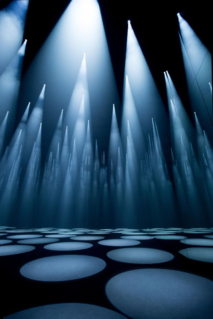 "Japanese architect Sou Fujimoto used spotlights, mirrors and specially composed sounds to create this ""shifting forest of light"" that responds to visitors' movements for fashion brand COS."