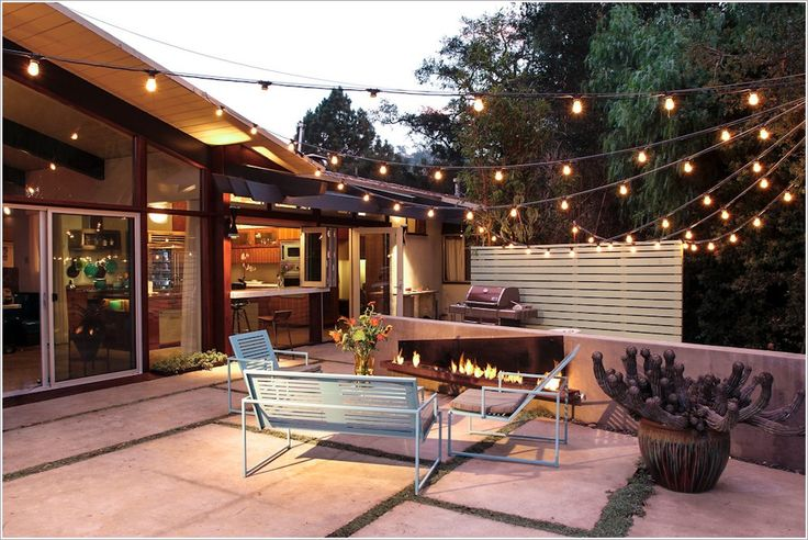 1) The white wood wall in the back is what we need for privacy from the neighbors.  2)  Those lights would be great for lighting the back yard. String them house to shed in a fairly permanent fashion.