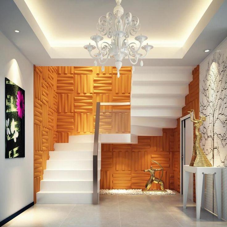 Gesso 3D na área da escada paredes, com pintura amarelo ouro.