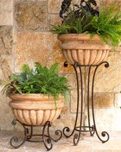 my note:  I think I should have been born wealthy, very wealthy!      I love these planters on the stands