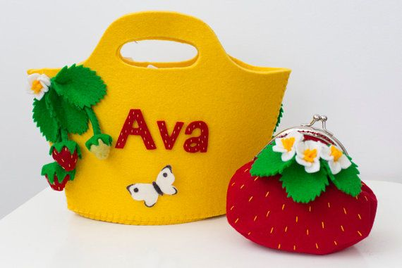 Strawberry handbag with matching strawberry coin purse. Can be personalized. From Babes in the Woods.