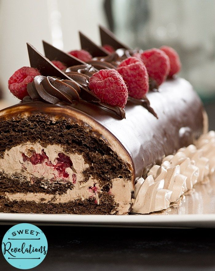 A recipe for a rich chocolate sponge cake full of buttercream and raspberries. Swiss Rolls look delectable and are not complicated!