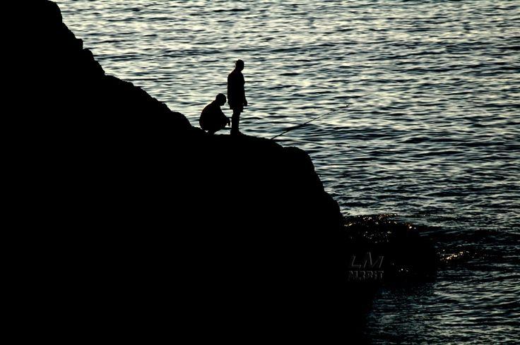 Pescatori al tramonto