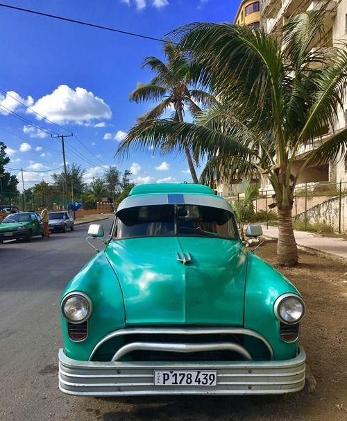"An old American refurbished car in Havana from ""Volunteer in Cuba with Global Volunteers: Forming Friendships, Building Bridges, and Helping Our Neighbors."""