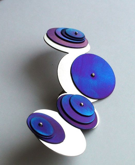 Saturn Brouch  Silver and titanium handmade brooch.