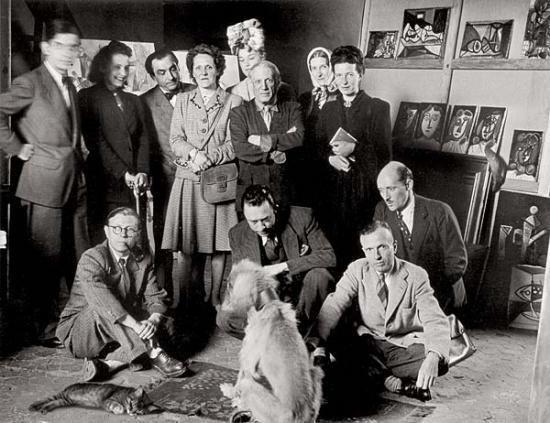 Brassai, Atelier de Picasso, 1944.(Jacques, Cécile Eluard, Pierre Reverdy, Louise Leiris, Zanie Aubier, Pablo Picasso, Valentine Hugo, Simone de Beauvoir. J.P. Sartre, A. Camus, M. Leiris, J. Aubier, Schnitzel le chat, Kazbek le berger afgan.