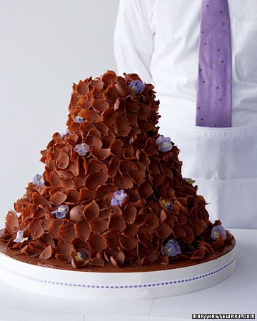 Hidden beneath a gentle flurry of bittersweet chocolate curls are three tiers of mocha spice cake made tender with sour cream