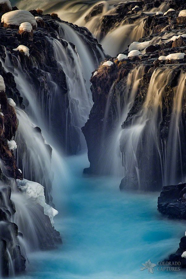 Hidden waterfalls of Brúarfoss in a snowy evening, Iceland  (by Mike Berenson)