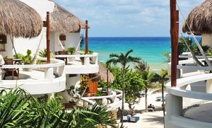 Groupon - Stay at Playa Palms Beach Hotel in Playa del Carmen, Mexico, with Dates Into October. in Playa del Carmen, Mexico. Groupon deal price: $135