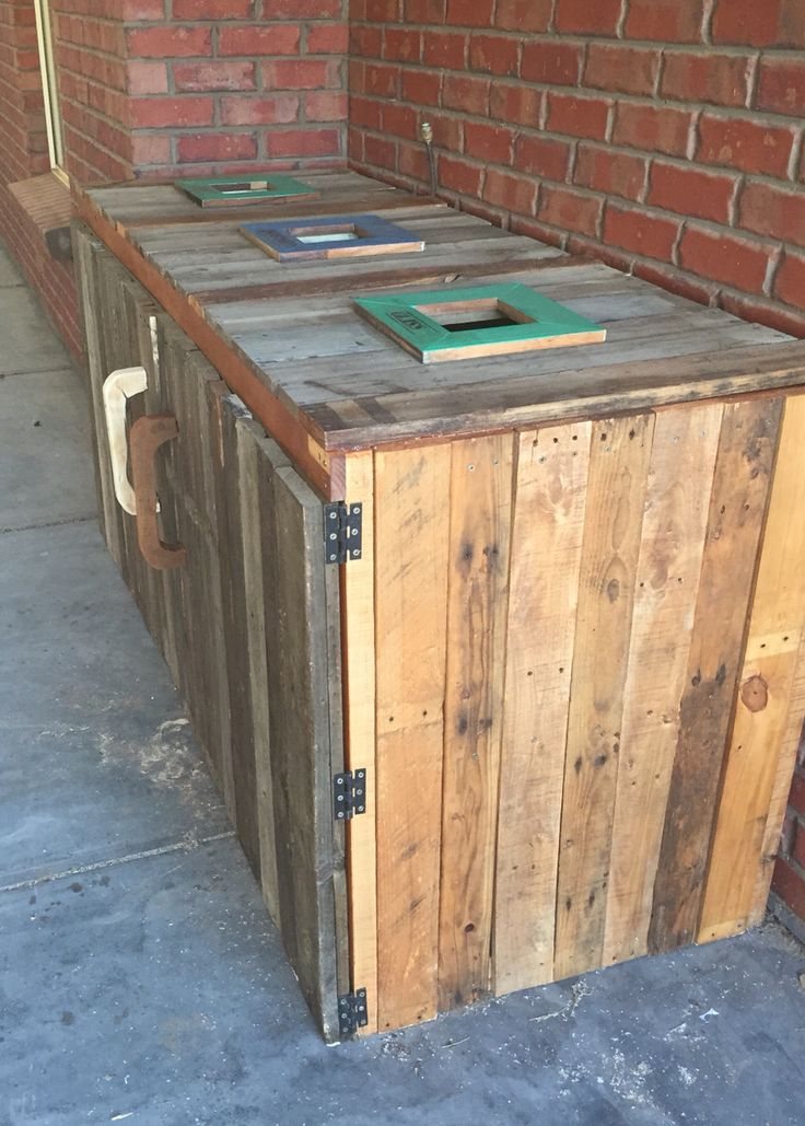 I thought I'd make this to store the drums in that they get put in. There is three holes, glass  plastics and Cans.  Made out of old pallets and other recycled wood