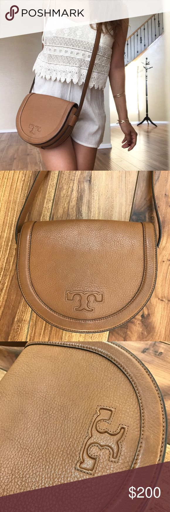 • Tory Burch Crossbody • This saddle brown leather crossbody is the perfect size to fit all of your needs! It's called the Tory Burch Serif T Leather Saddle Bag, Bark. It features the classic Tory Burch brand symbol, magnetic flap, back pocket, & interior zipper pocket. It does have a little bit of denim stain on the inside, but honestly not visible since that side is not shown when wearing it.  • Ask all questions prior to purchase • Bundle & save  • Feel free to make your best offer…