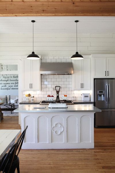 love lights.  love character to island.  She did cement counters and stainless steel on island.  Fun idea.