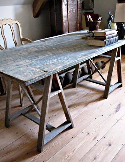 Old door used as a table top with a trestle leg base. Would be great as a  HS table for