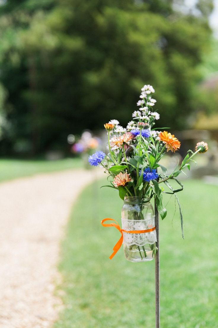 Jar Flowers Hooks Outdoor Relaxed Budget Friendly Village Hall Wedding http://www.lisadawn.co.uk/