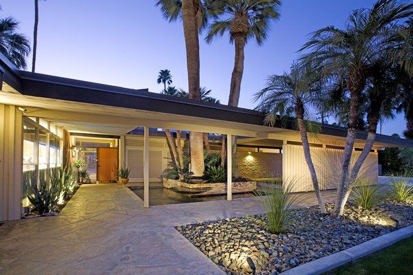 A fountain that spills into a palm sheltered pond at the entry. Photo 2 of 16 in A Luminous Palm Springs Midcentury Asks $3.35M. Browse inspirational photos of modern outdoor spaces.