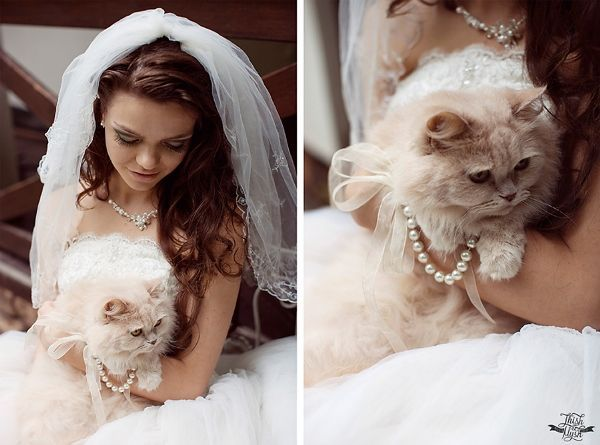 bride and her cat on her wedding day