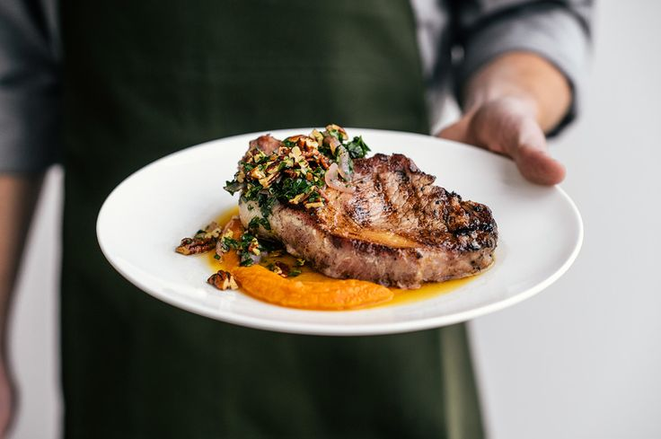 Ham-brined Porkchop with sweet potato puree, braised greens and pecan relish    Refined country cooking by Chef Matthew McClure    Photography by @Magnus Lindqvist  Styling by @Monica Claerbout