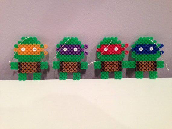 This is a 4-piece set of Ninja Turtles Christmas ornaments. Each ornament measures 2 1/4 inches in length. Includes Michelangelo, Donatello, Leonardo,