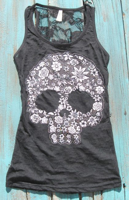 It's out of stock, but I will have this. Sugar Skull Tank Top  https://www.elusivecowgirl.com/catalog/tanks-tunics/sugar-skull-tank-top