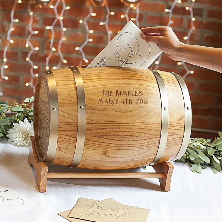 A unique way to collect wedding cards and gifts is with the Personalized Wine Barrel Reception Gift Card Holder. This barrel card holder features pine wood and metal rings, a card slot, and a magnetic door for easy removal of cards. Place on a reception table or near the guest book during the wedding then place in your home for a unique wedding keepsake.