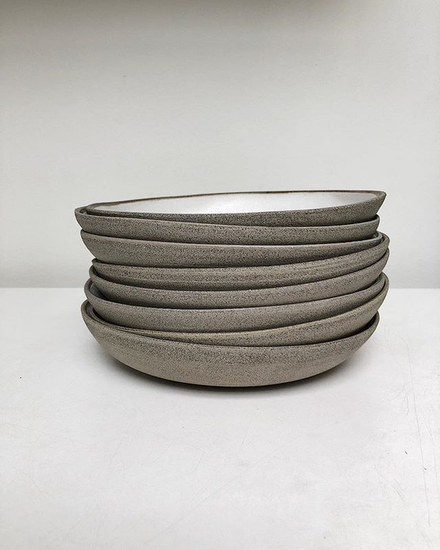 A slinky grey stack. . 20cm handbuilt pasta bowls from the Bespoke Grey series in White. Microwave and dishwasher safe. Discover the range online (link in bio). . . . . . . . #pottery #ceramics #stoneware #potter #twinearthceramics #dinnerware #food #tabletop #cheflife #foodblogger #restaurant #michelinstar #rustic #tableware #styling #textures #minimal #design #natural #handbuilt #handmade #propshop #platesforchefs #chefsofinstagram #plate #naturallight #sustainability #recycle #maker…