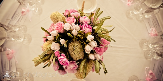 Native Australian flowers intertwined with pink roses.. just beautiful!
