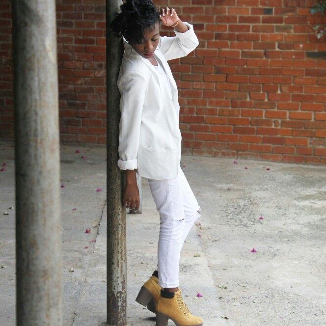 white blazer, white distressed denims and mustard boots